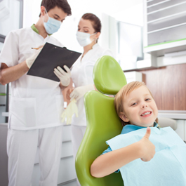 child in chair at dentist