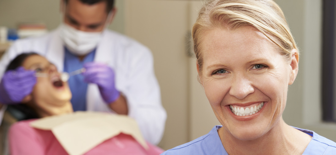 dental assistant smiling during appointment