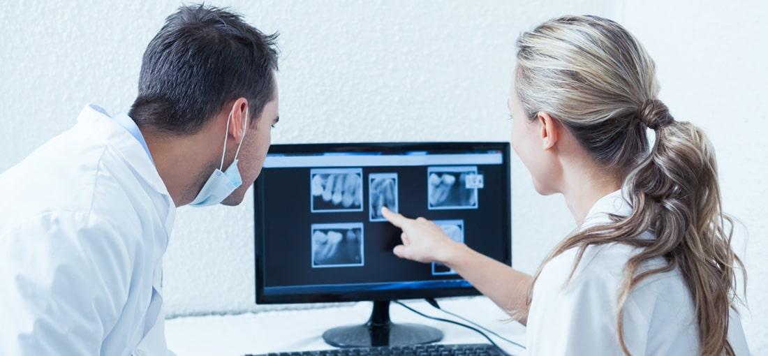 dentist examining mouth xrays