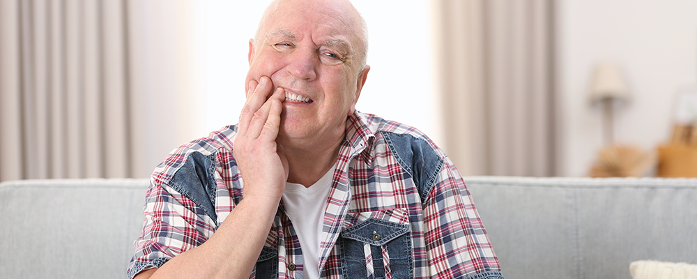 man suffering from TMJ pain