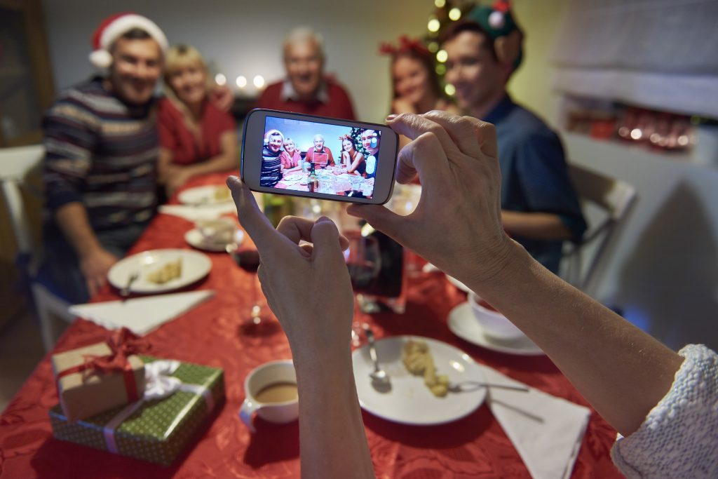 Family Smiling for Photo During Holidays