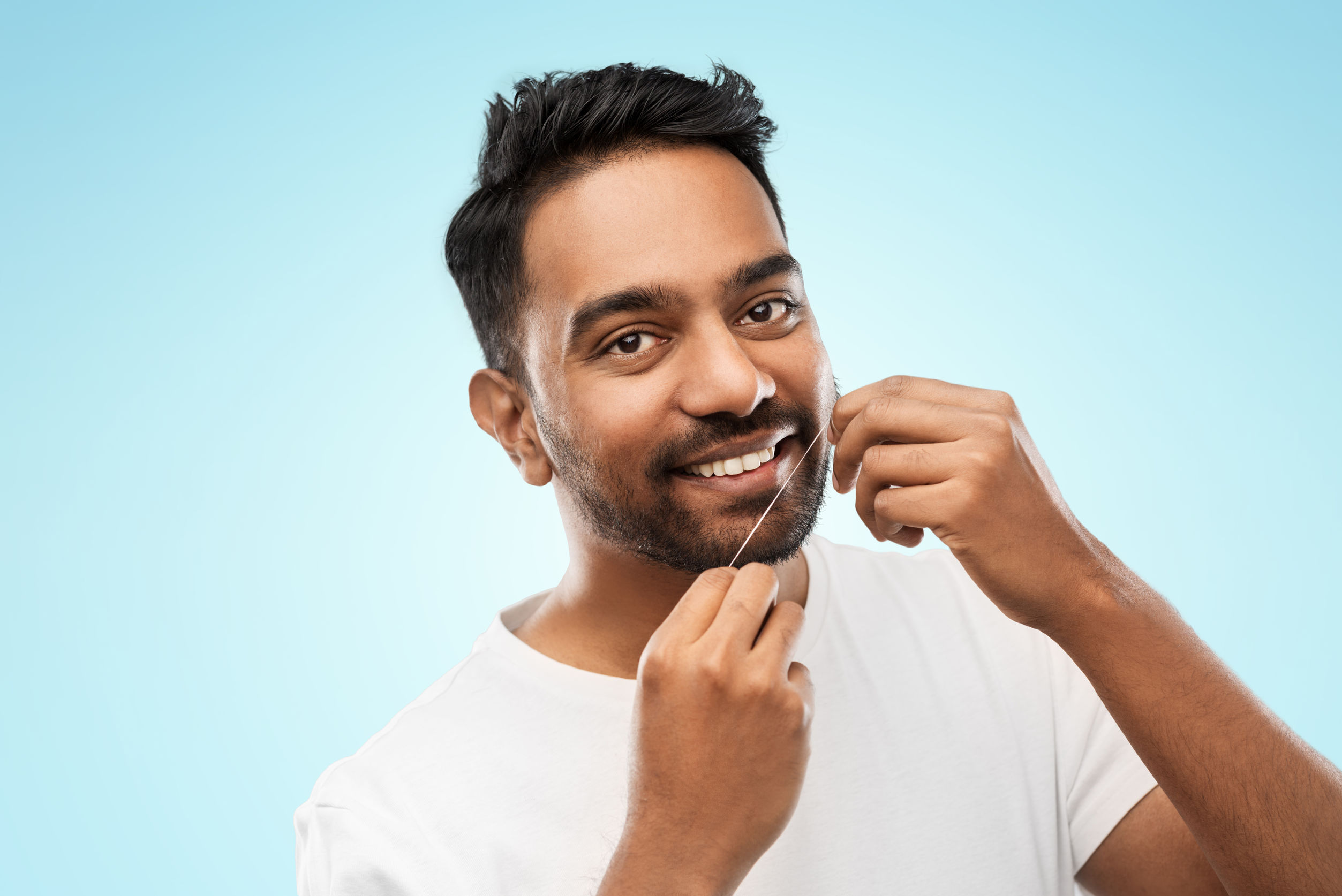 Man flossing with scented dental floss